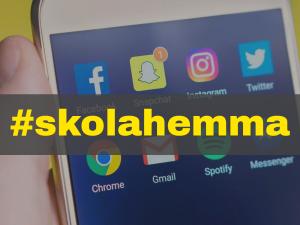 Hashtag #skolahemma med smartphone i bakgrunden